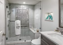 Beautiful-little-glass-dolphin-is-the-only-fetaure-that-adds-color-to-this-contemporary-gray-bathroom-217x155