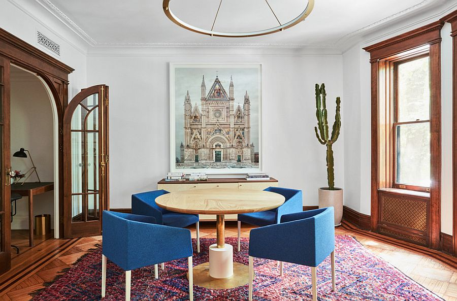 Beautiful rug adds to the color scheme of thise dining roo in New York City home