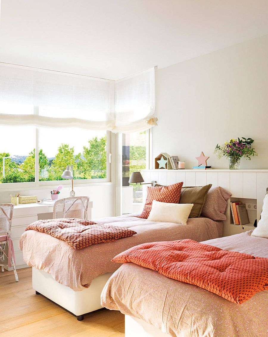 Bedding and greenery outside bring color into this little white bedroom