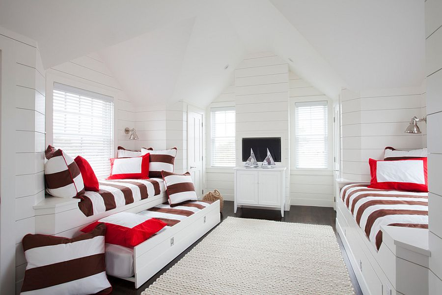Bedding in the trundle beds brings color to the white bedroom