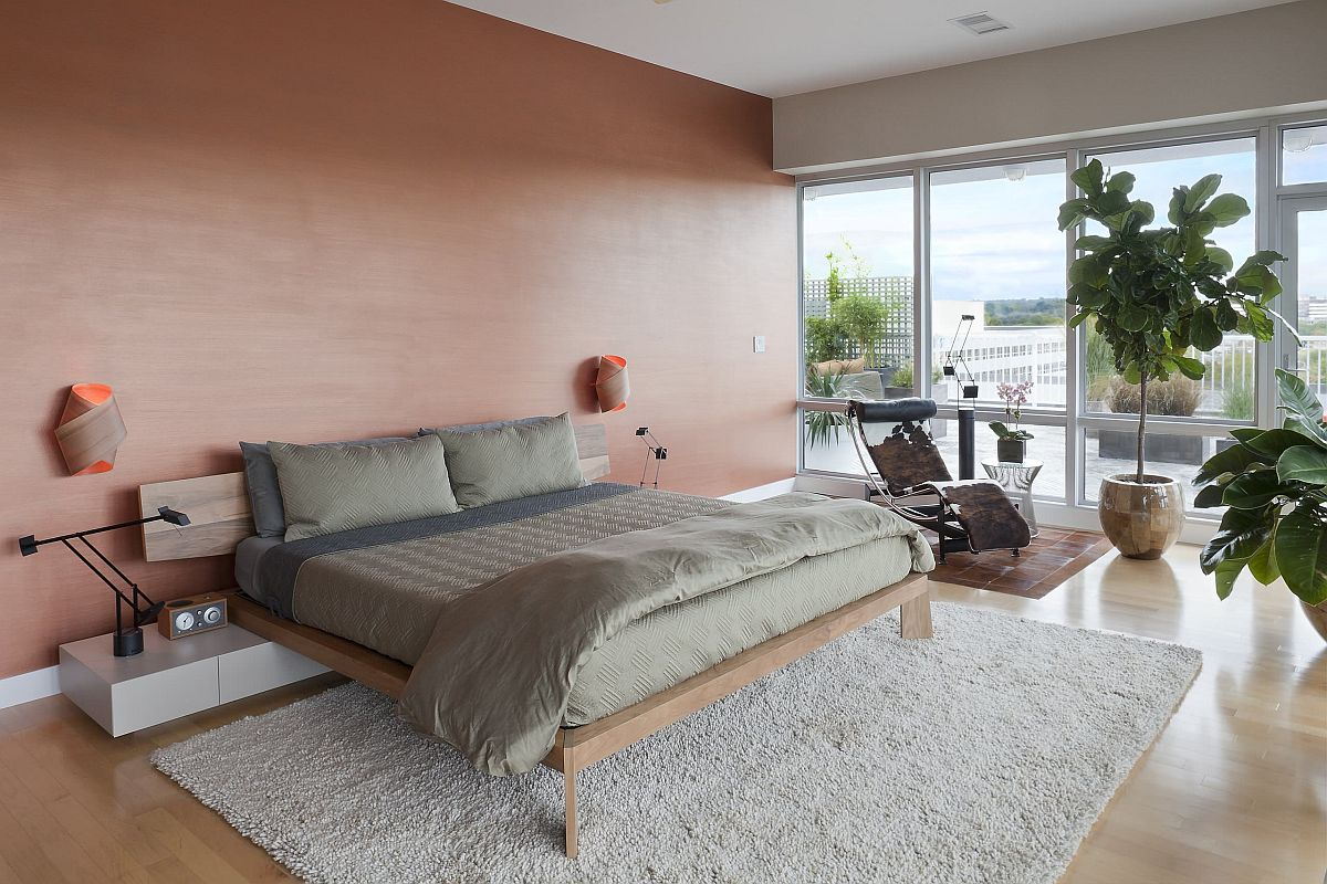 Bedroom with minimal platform bed and wooden accent wall