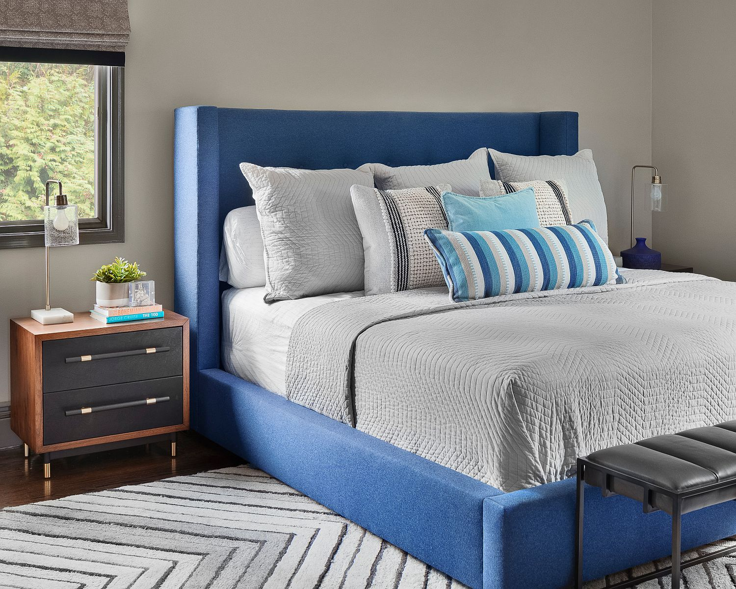 Bedside table and headboard usher in midcentury vibe into the modern bedroom with a dash of blue