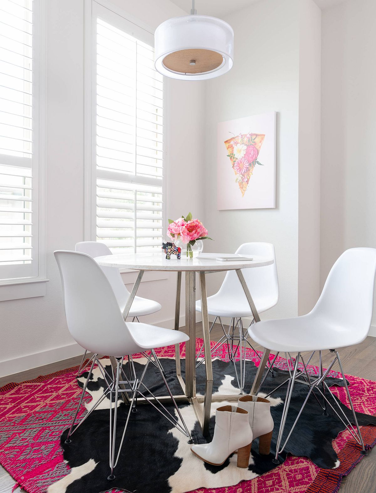 Bold and eclectic rug brings color and pattern to the small dining room