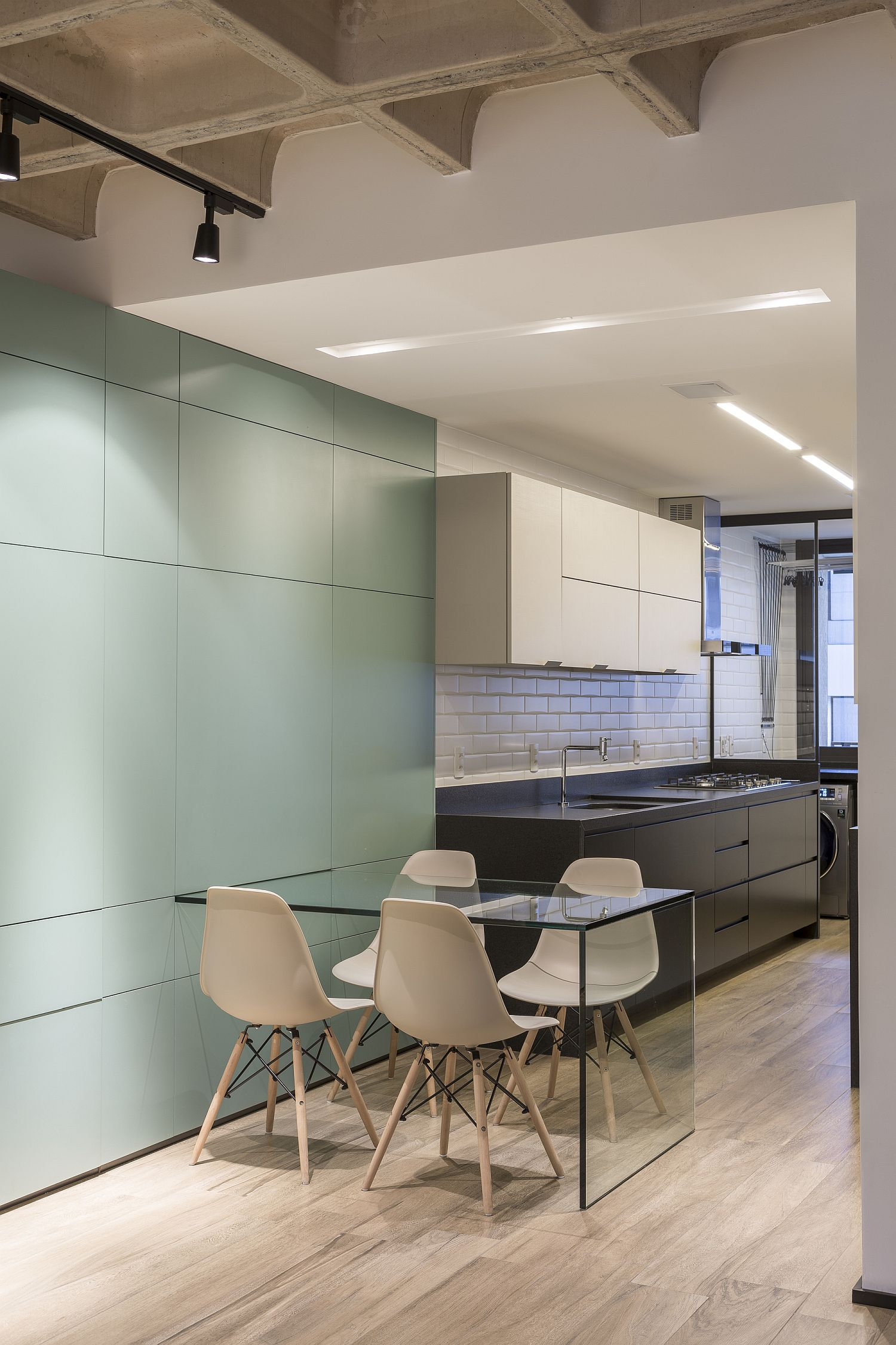 Bringing-out-the-dining-table-from-the-multifunctional-hallway-wall-unit