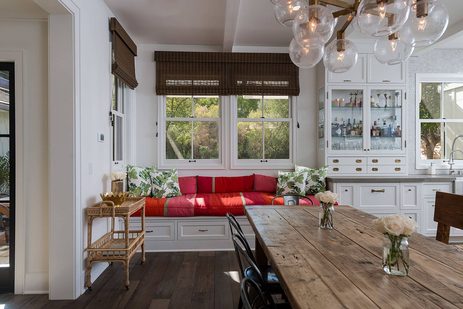 Built-in-bench-and-window-seat-for-the-kitchen-with-colorful-cushions-and-storage-options