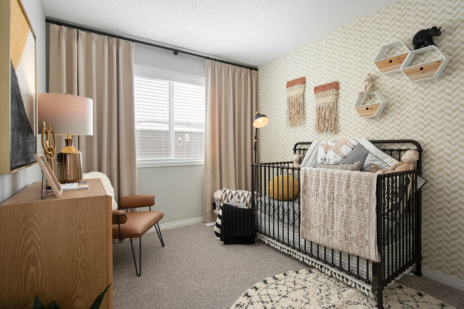 Chevron pattern backdrop for the small eclectic nursery in neutral hues