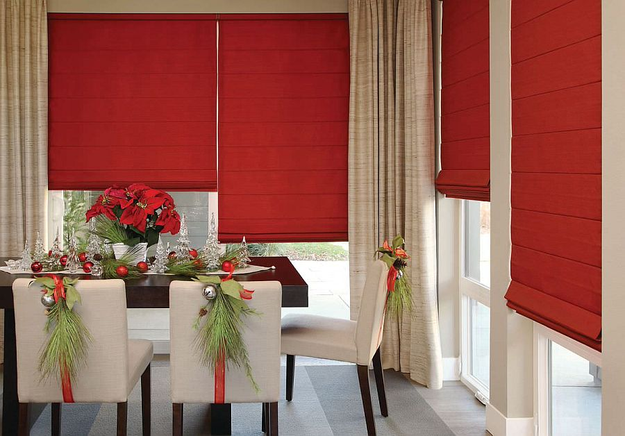 Christmas-themed dining room with beautiful red window shutters that steal the spotlight
