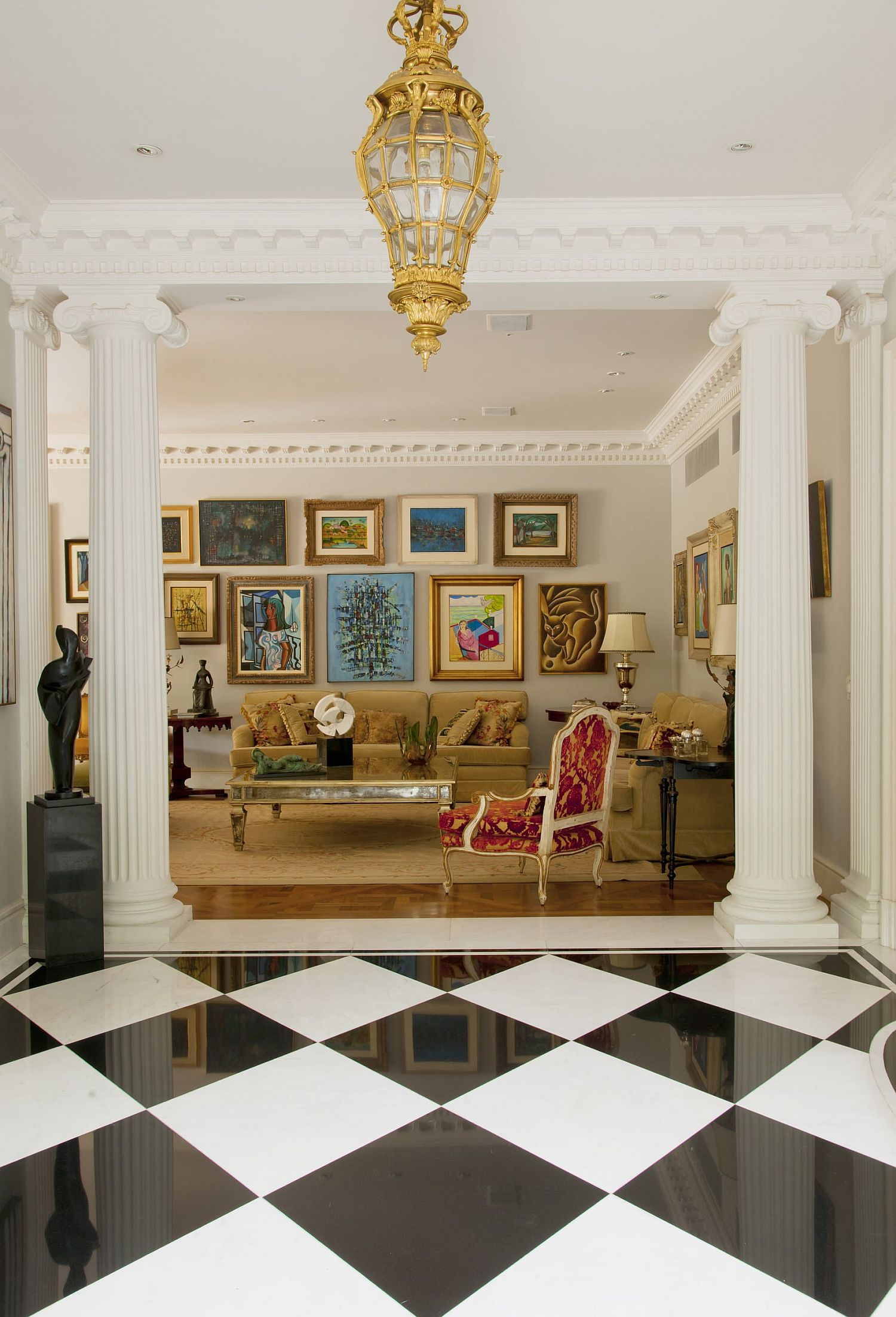 Collection of art pieces combined to create a beautiful gallery wall in the classic living room with French panache