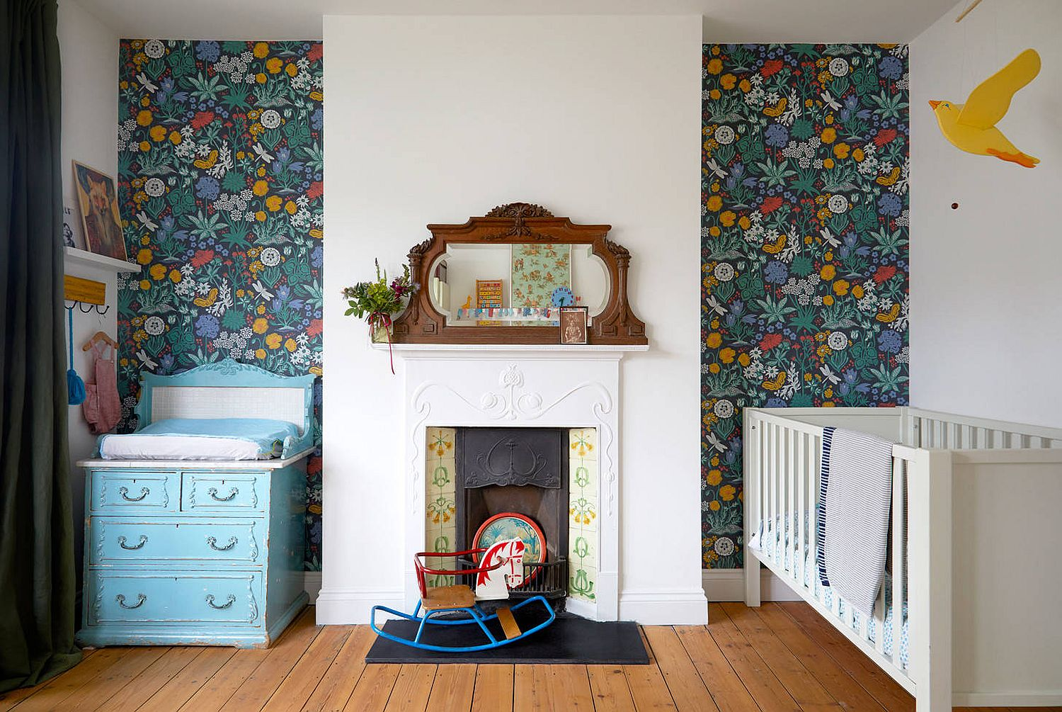 Colorful and unique wallpapered backdrop for the small nursery with an eclectic appeal