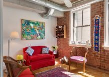 Combining-industrial-and-eclectic-styles-in-the-small-living-room-with-brick-wall-and-concrete-ceiling-217x155