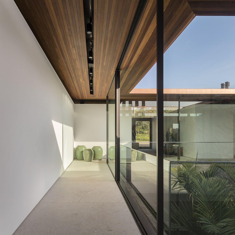 Covered walkways and patios aroundthe Brazilian home