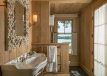 Custom-mirror-frame-for-the-small-rustic-bathroom-fetauring-wood-walls-and-stone-flooring-217x155