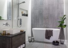 Custom-zinc-and-wood-vanity-accent-wall-and-floor-bring-gray-to-this-bathroom-217x155