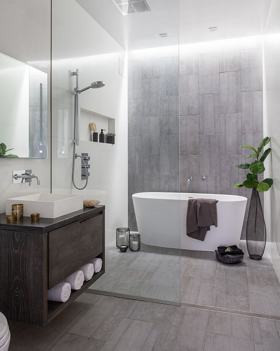 Custom-zinc-and-wood-vanity-accent-wall-and-floor-bring-gray-to-this-bathroom