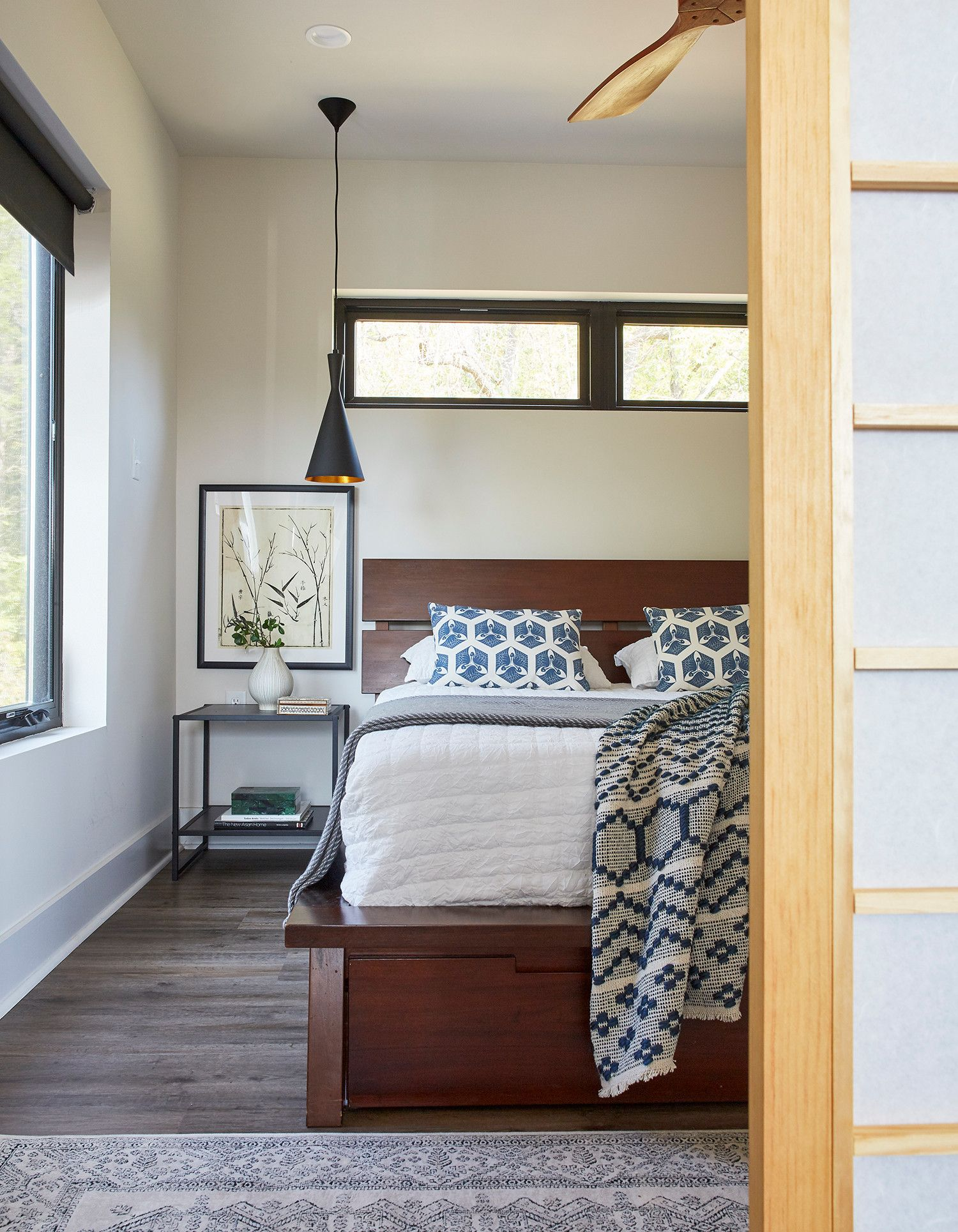 Dashing Tom Dixon pendant used as bedside lighting in the small urban bedroom with sliding door