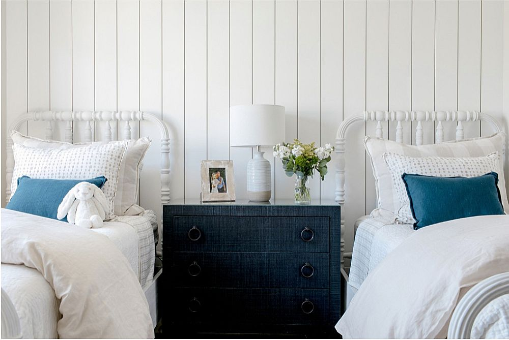 Dashing pops of dark blue for the cheerful beach style bedroom
