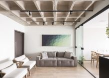Dashing-wall-art-piece-brings-color-to-the-living-space-in-white-and-concrete-217x155