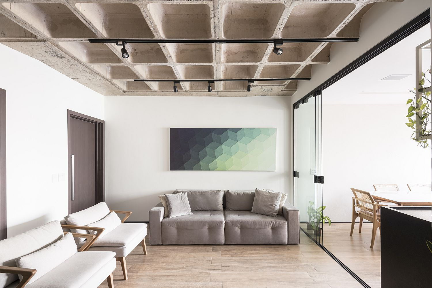 Dashing-wall-art-piece-brings-color-to-the-living-space-in-white-and-concrete