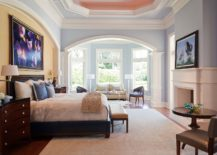 Decorating-the-wall-above-headboard-and-the-fireplace-mantle-with-wall-art-that-is-eye-catching-217x155
