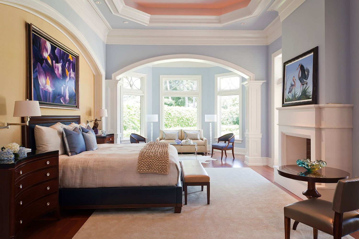 Decorating the wall above headboard and the fireplace mantle with wall art that is eye-catching