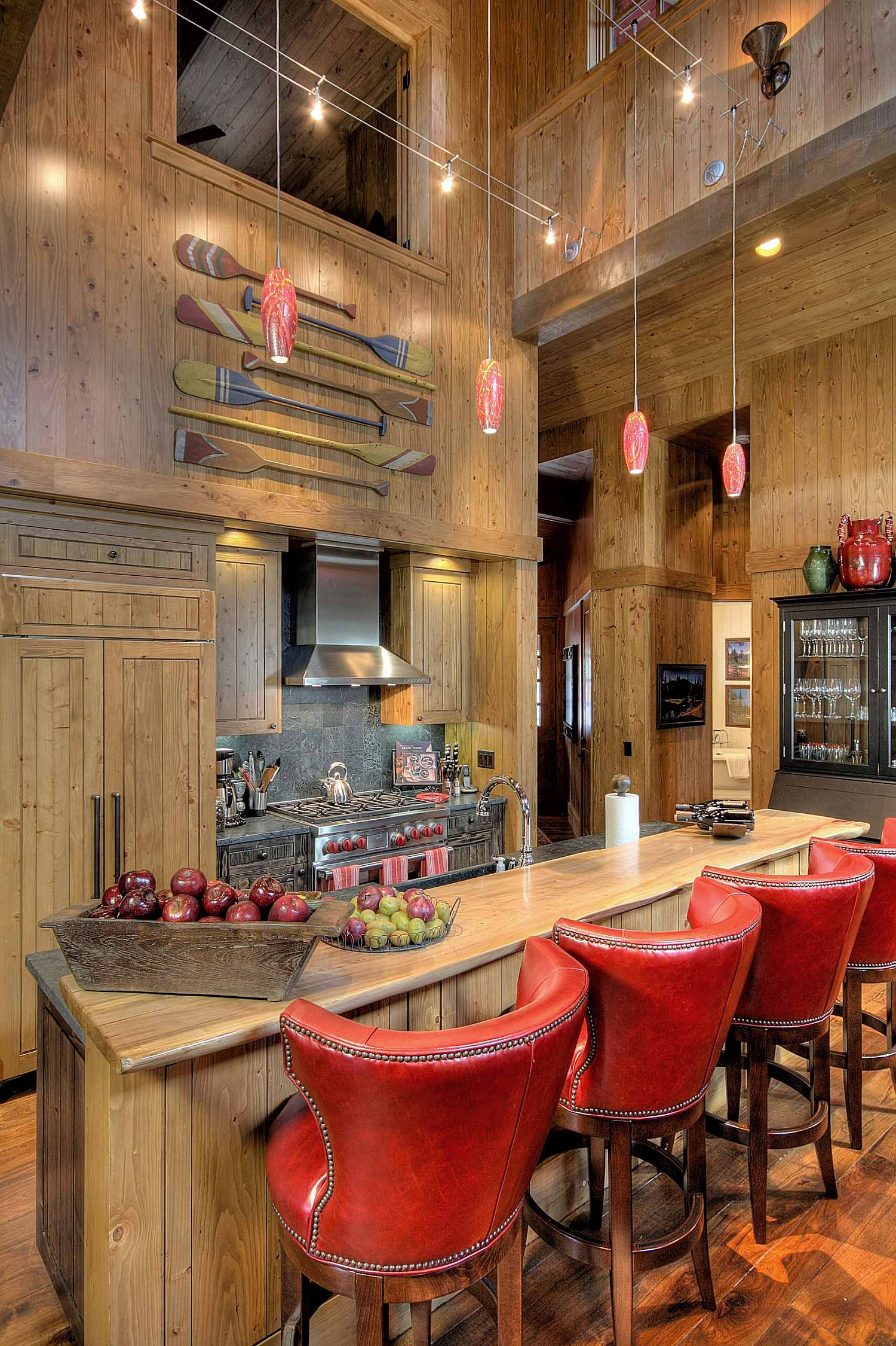 Delightful blend of wood and red in the spacious rustic kitchen