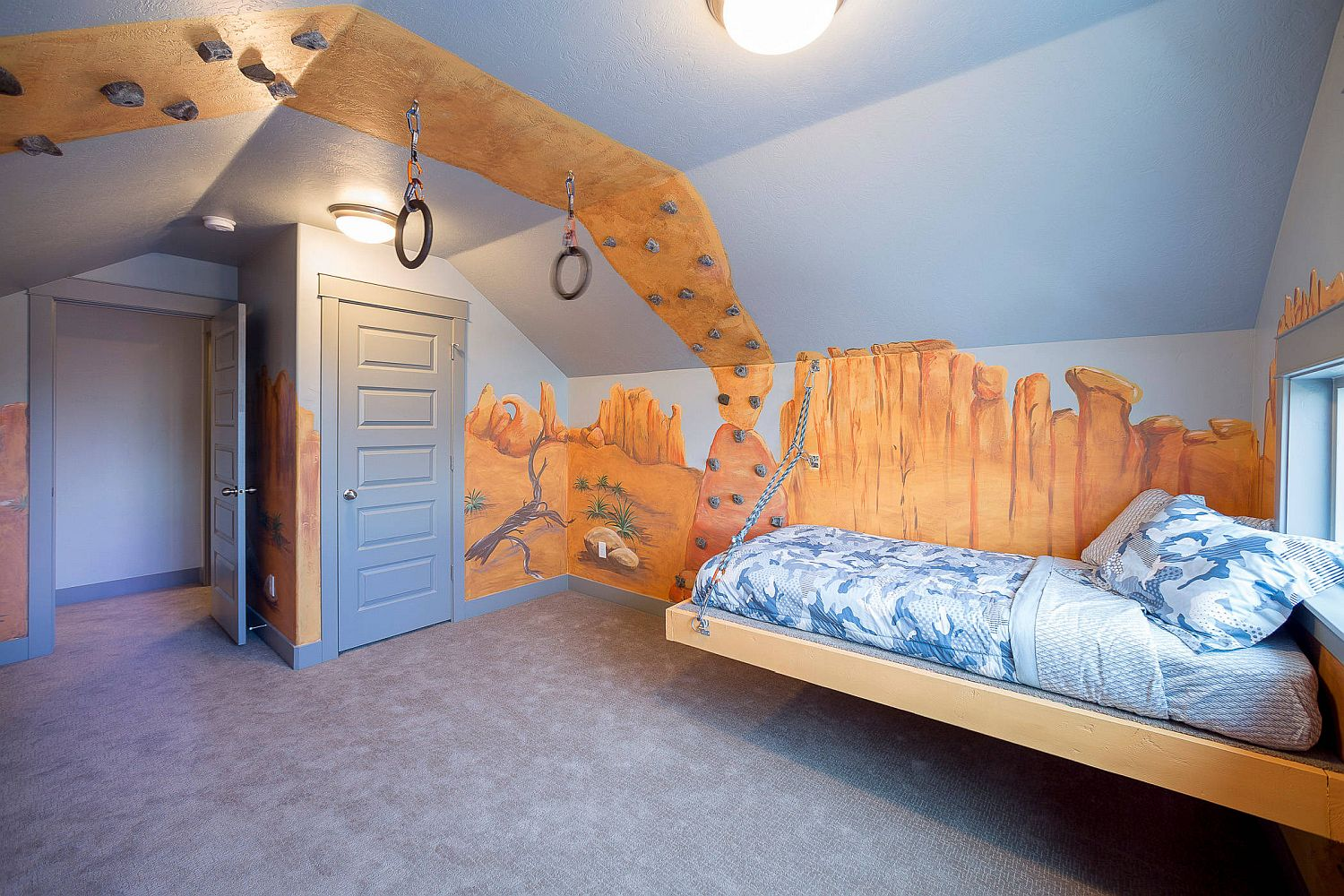 Design a more athletic and unique kids' bedroom with rings and climbing wall
