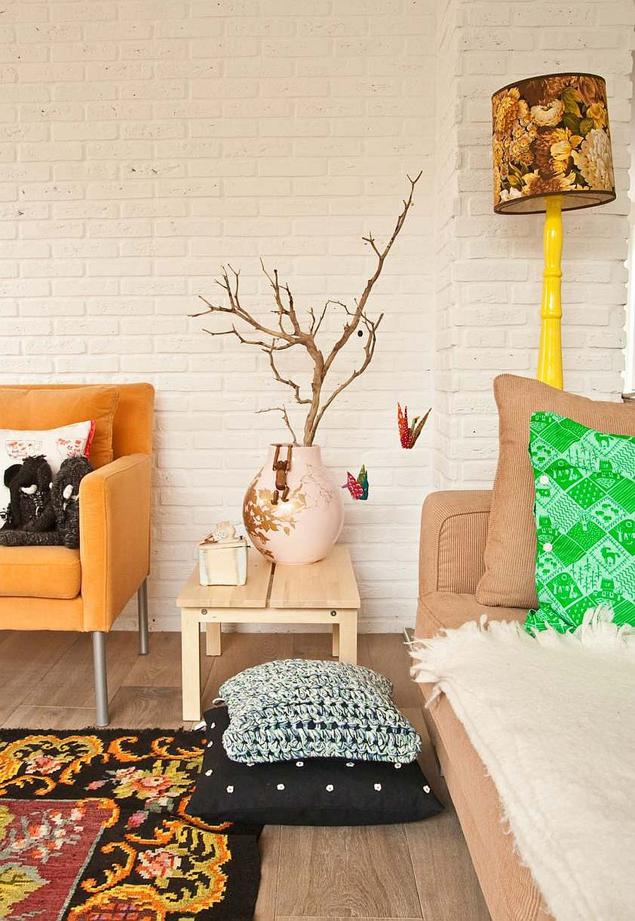 Eclectic living room of Amsterdam home uses accents in multiple hues with delightful ease