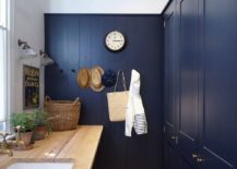 Elegant-and-space-savvy-laundry-in-deep-navy-blue-and-white-with-modern-and-coastal-styles-rolled-into-one-217x155
