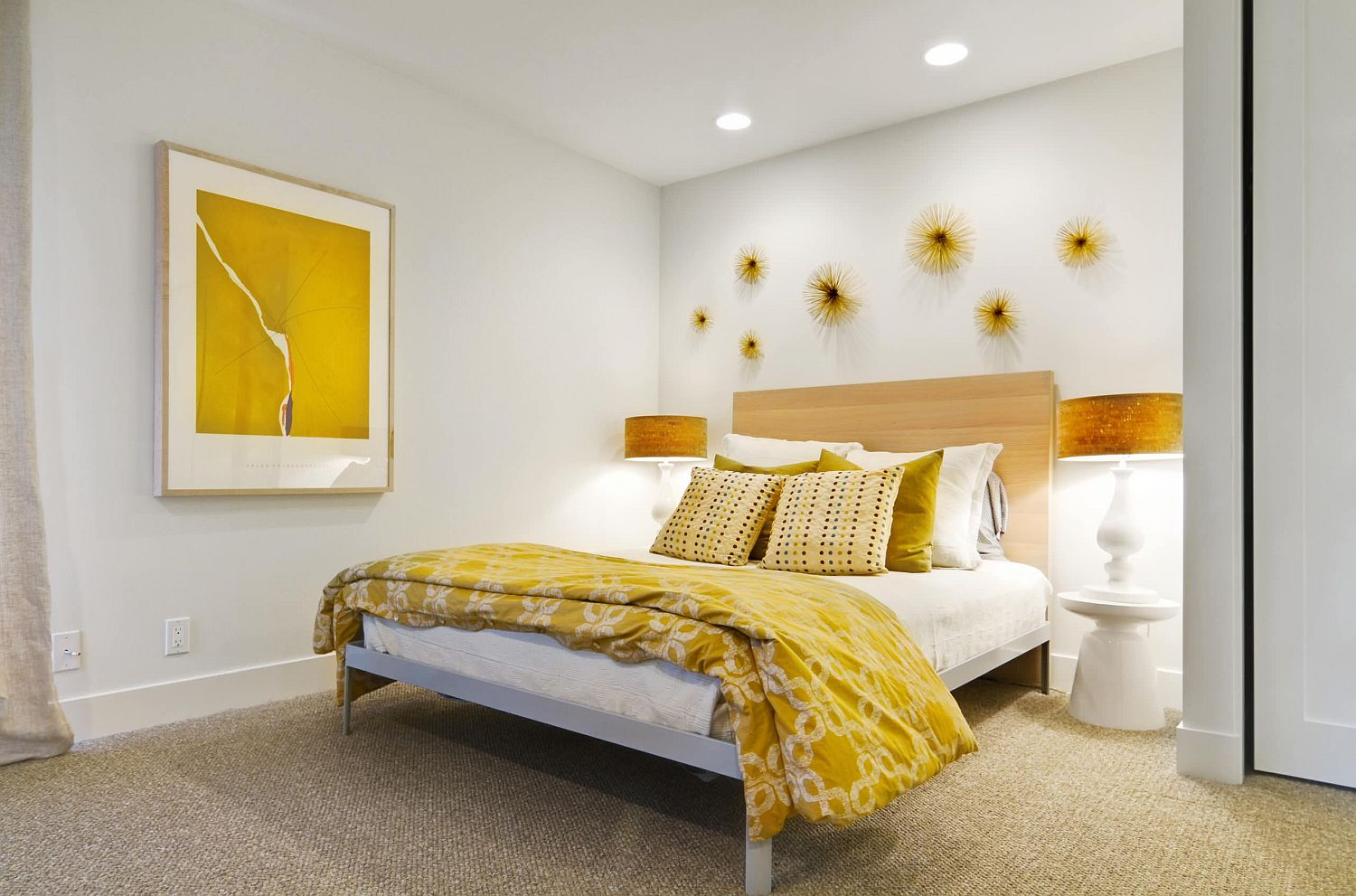 Elegant pops of gold and yellow for the modern bedroom in white