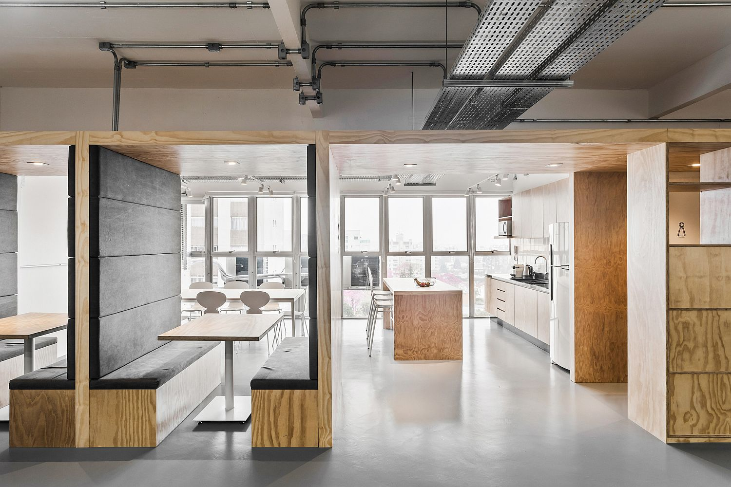 Exposed industrial elements are coupled with modernity inside this multi-level Brazilian office