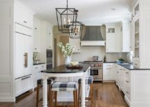 Extended-kitchen-island-with-breakfast-bar-that-has-classic-bar-stools-to-complement-its-look-217x155