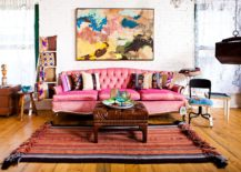 Fabulous-pink-sofa-anchors-this-exquisite-brick-wall-living-room-with-eclectic-style-217x155