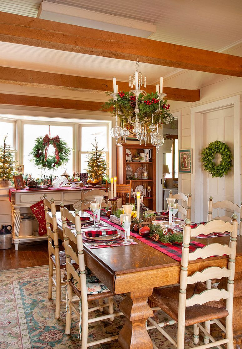 Farmhouse style dining room decked out with Christmas decorations everywhere
