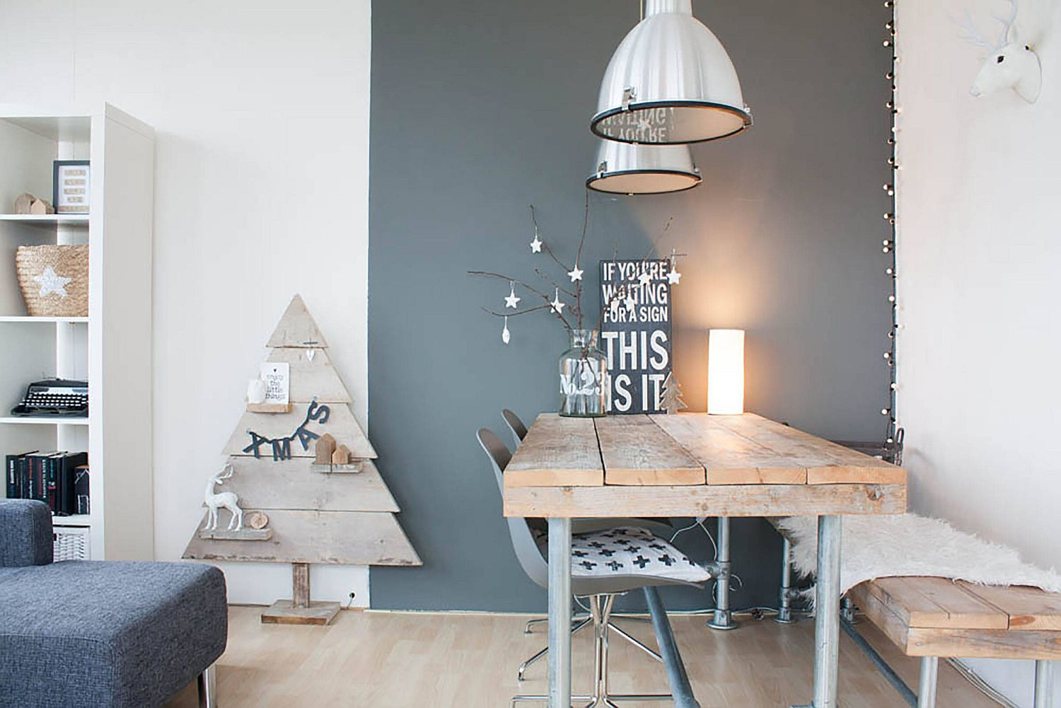 Festive gray and white dining room with a unique Christmas tree and modern Scandinavian style