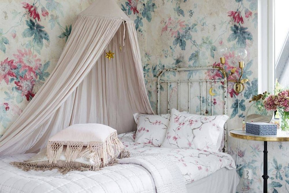 Flowery pattern for the walls sits perfectly into the narrative of the bright shabby chic kids' room