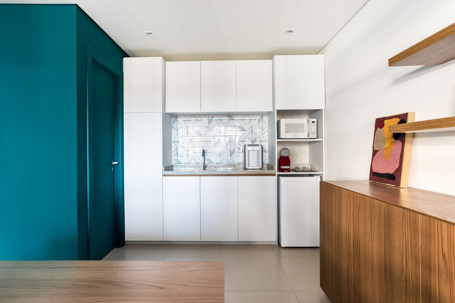 Functional kitchen and spacious workspaces inside the office