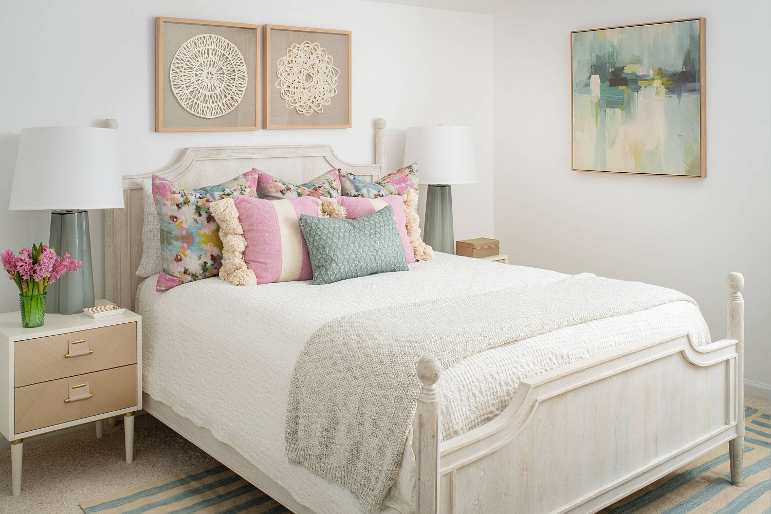 Gentel pastel blue and pink accents for the relaxing bedroom in white with coastal chic style