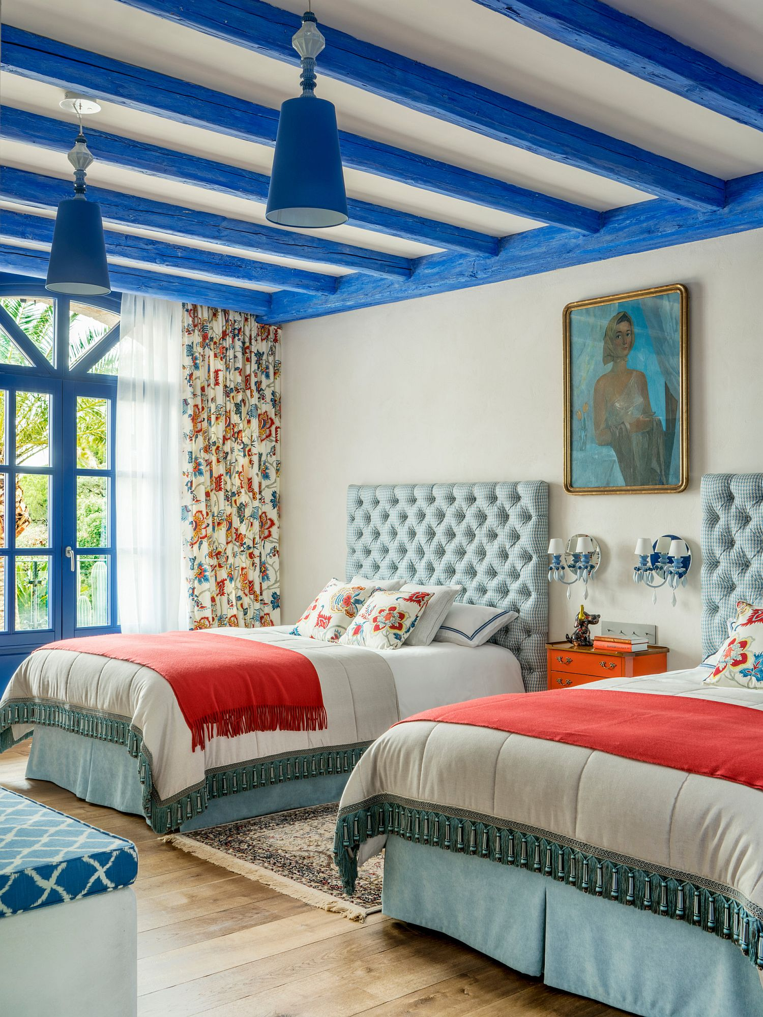 Gorgeous ceiling beams in blue bring color to the spacious modern Mediterranean kids' room