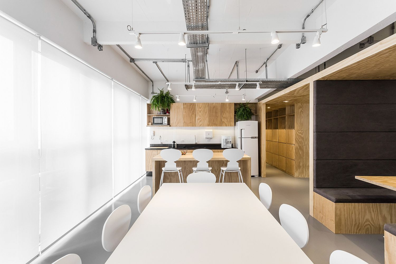 Gorgeous use of gray, white and wood inside the office