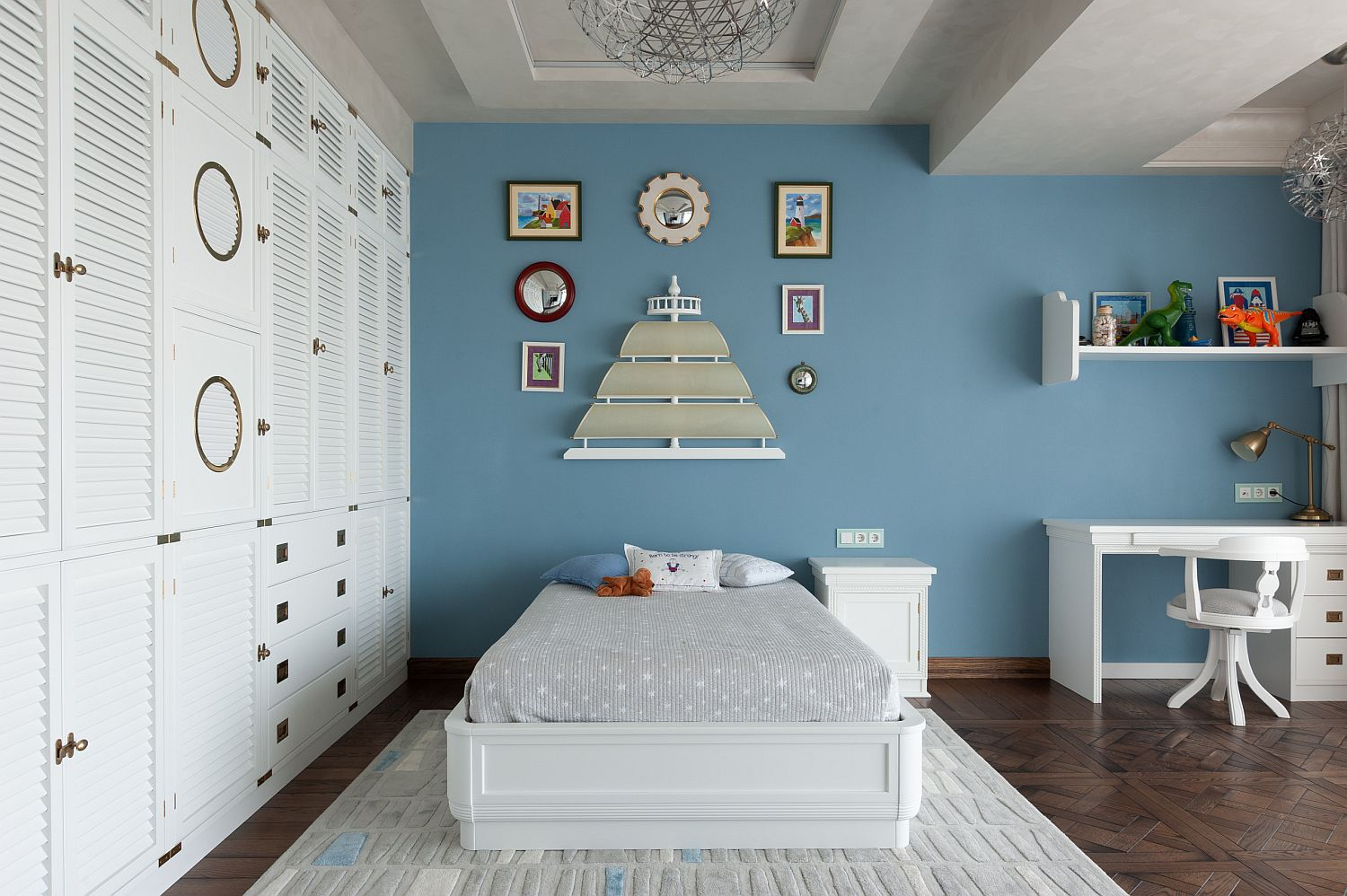 Gray and white kids' bedroom with accent wall in blue