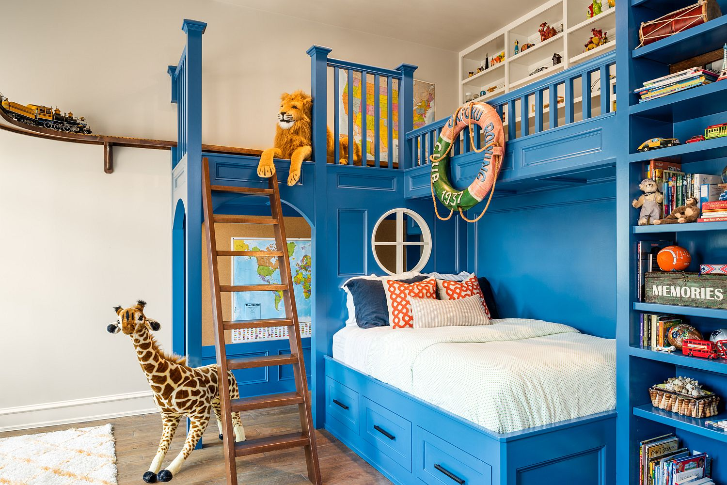 It is the amazing bunk bed with custom shelves steals the show in here