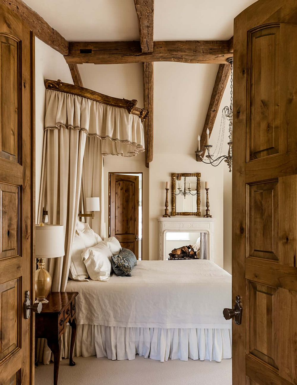 It is the bed that steals the show in this lovely rustic bedroom in white