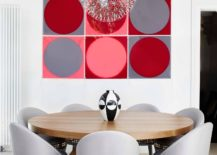 It-is-the-wall-art-that-adds-color-to-this-contemporary-dining-room-217x155