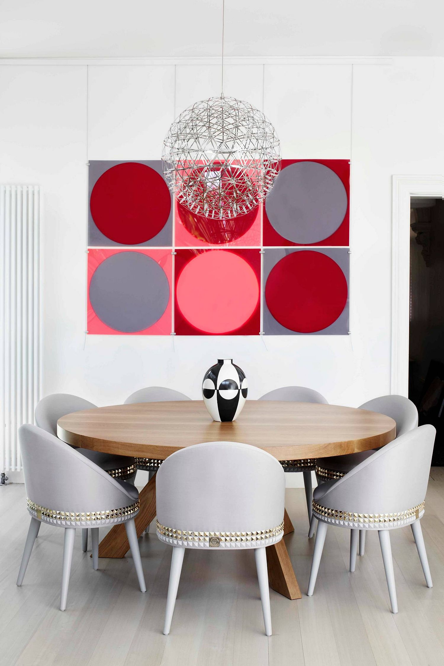 It is the wall art that adds color to this contemporary dining room