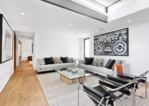 Large-black-and-white-wall-art-piece-for-the-living-room-does-not-disturb-its-color-scheme-217x155