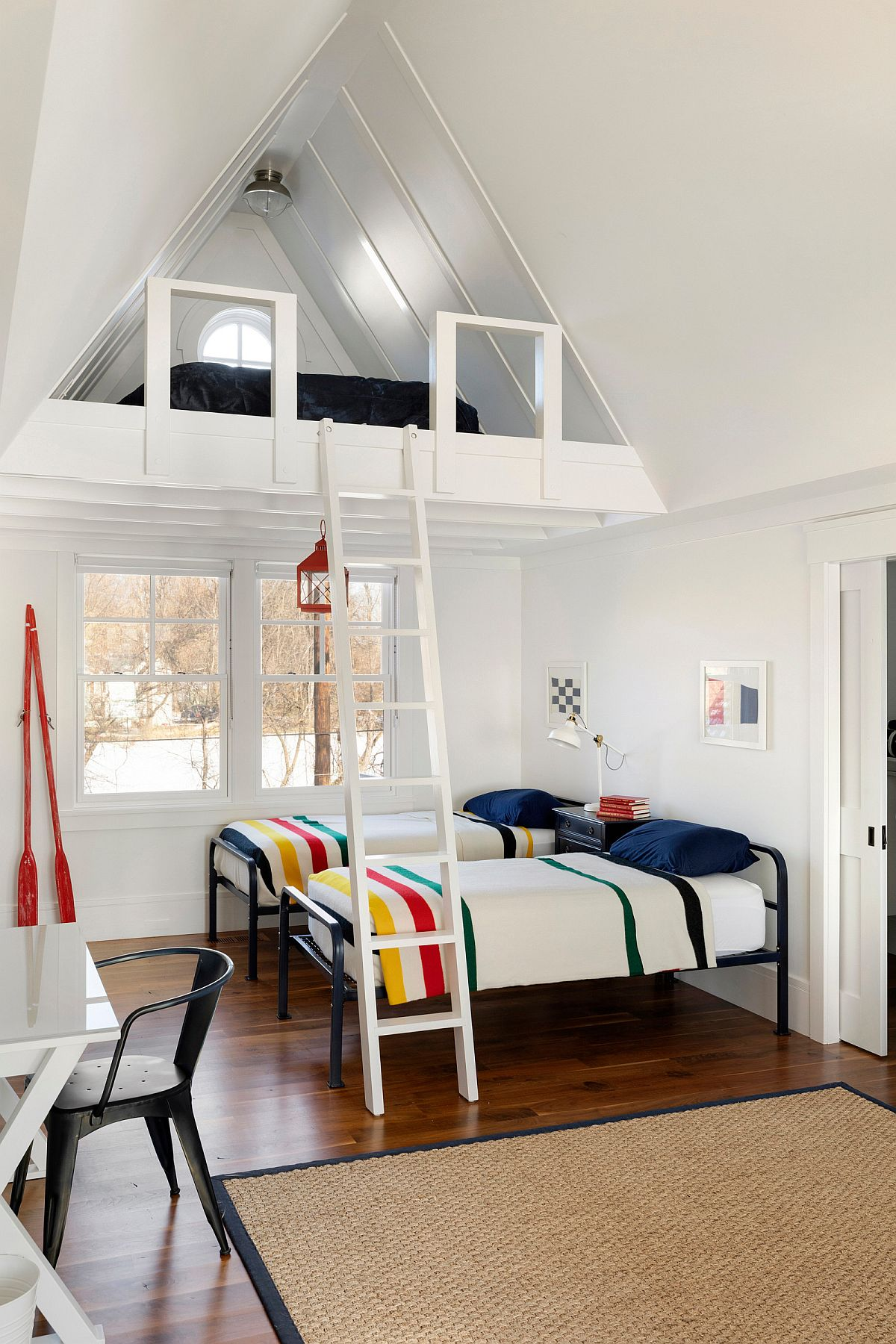 Making most of the vertical space in the all-white beach style bedroom
