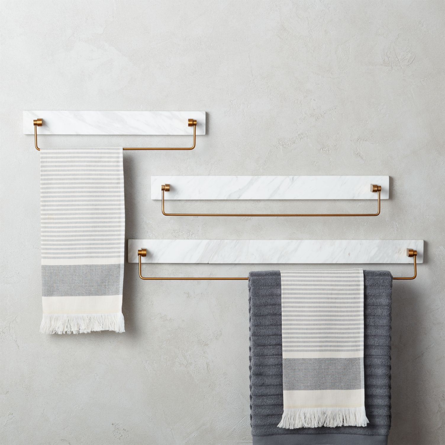 Marble towel bars with gold detailing