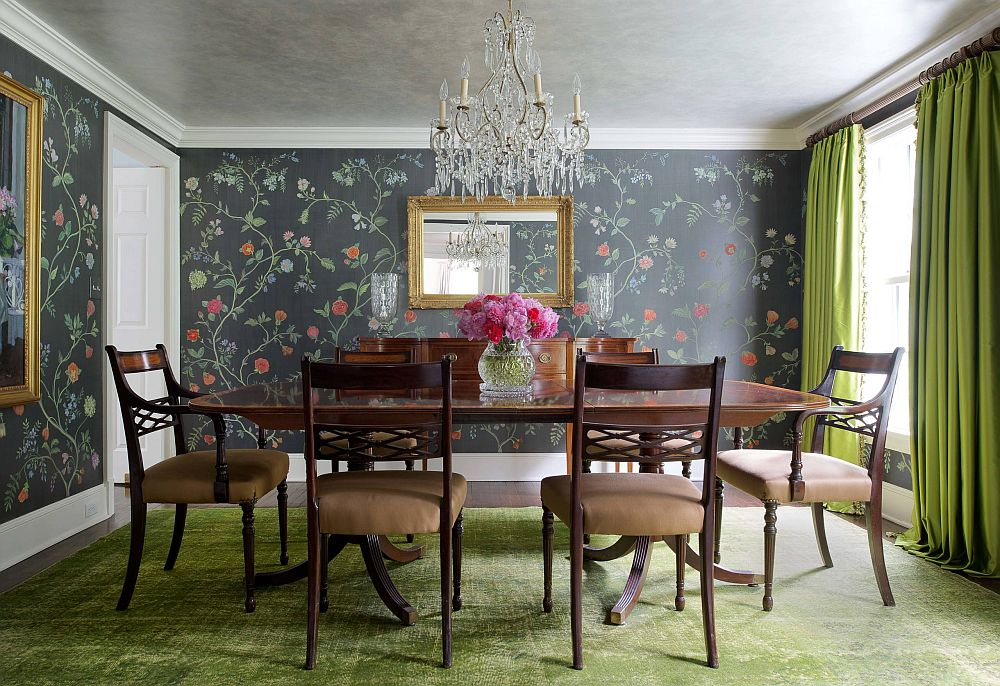 Match color of the rug with those of the drapes to create a more curated adnd elegant dining room with a bright chandlier at its heart
