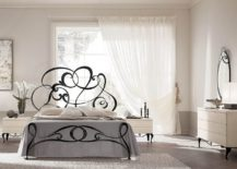 Metal-scrolled-bed-gives-the-classic-wrought-iron-bed-frame-a-brilliant-modern-twist-217x155