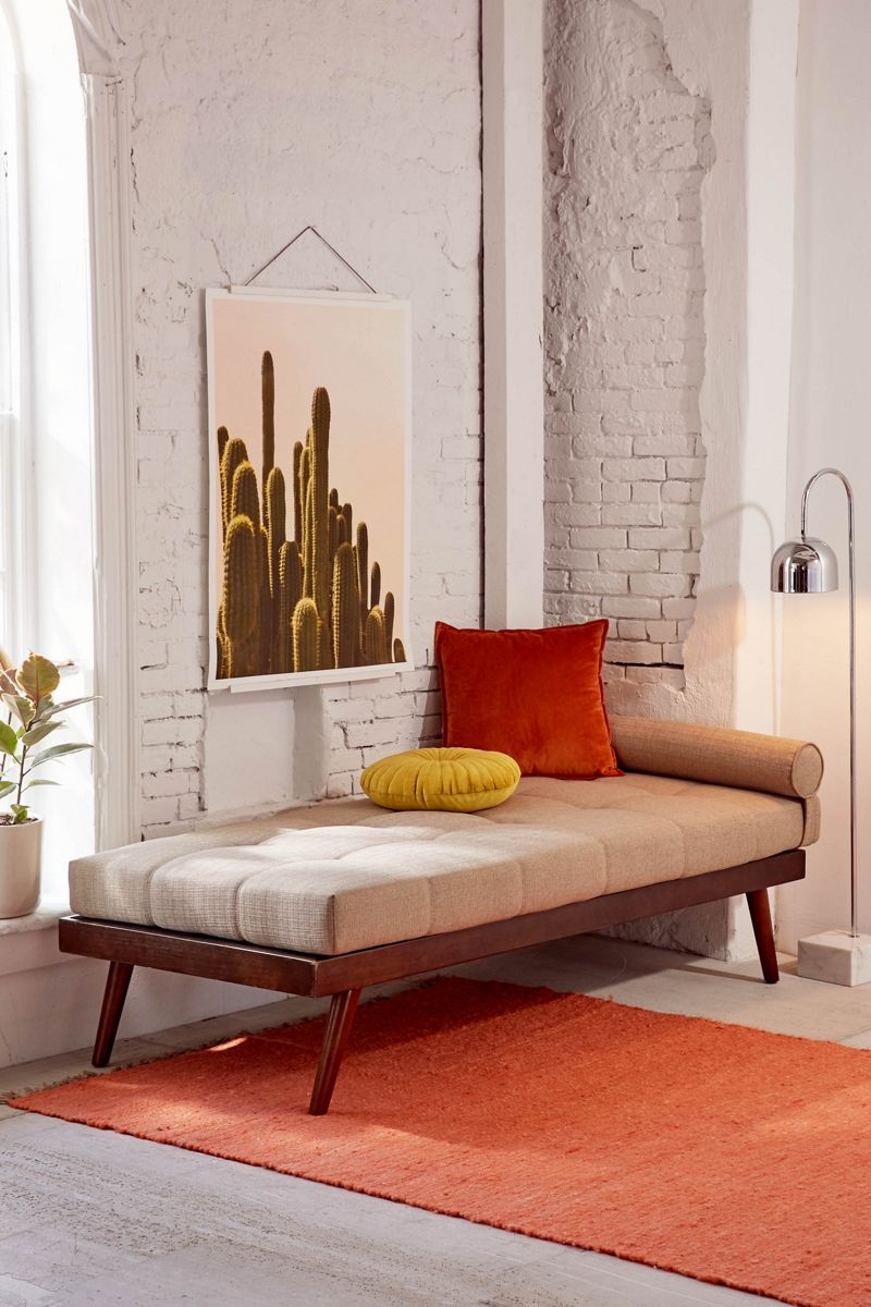 Midcentury-style daybed with wooden legs